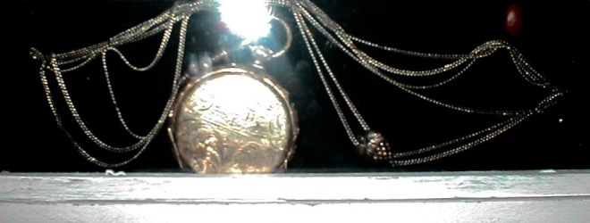Katie Andrus' locket-has Rod's pic inside.jpg